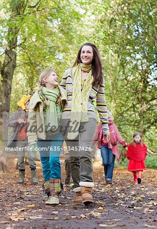 Family walking in park in autumn Stock Photo - Premium Royalty-Free, Image code: 635-03457426