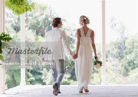 Bride and groom holding hands Stock Photo - Premium Royalty-Free, Image code: 635-03515461