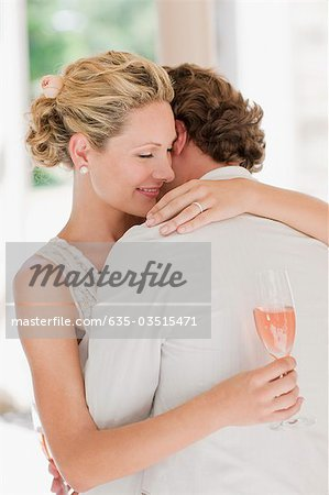 Bride and groom hugging Stock Photo - Premium Royalty-Free, Image code: 635-03515471