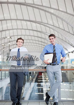 Businessmen waiting in train station Stock Photo - Premium Royalty-Free, Image code: 635-03515574