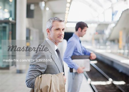 Businessmen waiting for train on platform Stock Photo - Premium Royalty-Free, Image code: 635-03515592