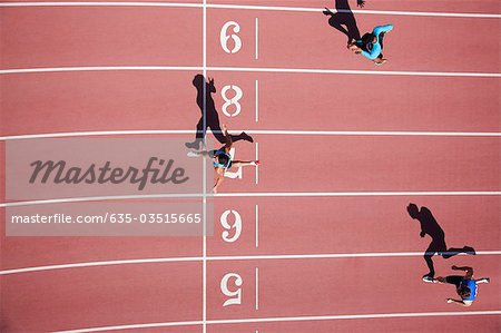 Runner crossing finishing line on track Stock Photo - Premium Royalty-Free, Image code: 635-03515665