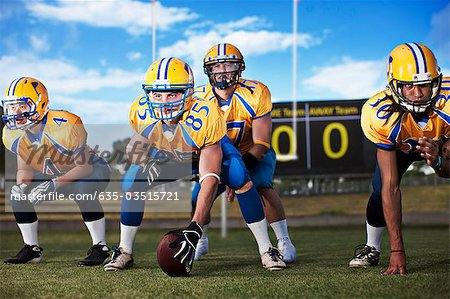 Football players preparing to play football Stock Photo - Premium Royalty-Free, Image code: 635-03515721