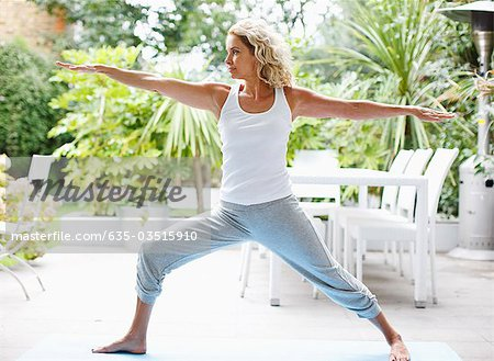 Woman practicing yoga Stock Photo - Premium Royalty-Free, Image code: 635-03515910