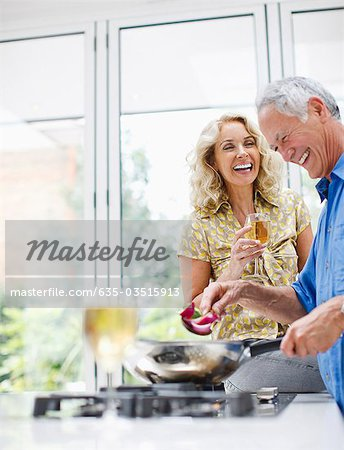 Couple cooking together Stock Photo - Premium Royalty-Free, Image code: 635-03515913
