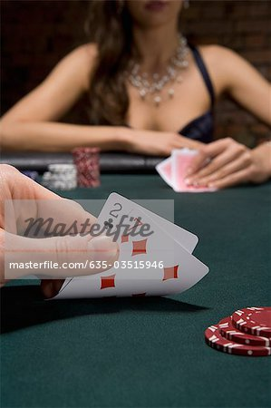 Close up of cards in casino Stock Photo - Premium Royalty-Free, Image code: 635-03515946