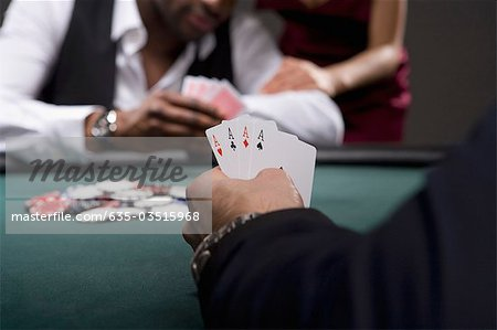 Man with four aces in casino Stock Photo - Premium Royalty-Free, Image code: 635-03515968