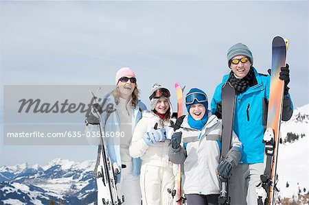 Family standing with skis Stock Photo - Premium Royalty-Free, Image code: 635-03516090