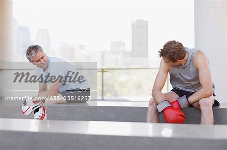 Boxer and coach resting after training Stock Photo - Premium Royalty-Free, Image code: 635-03516253