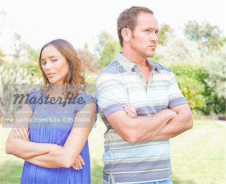 Arguing couple standing outdoors Stock Photo - Premium Royalty-Free, Image code: 635-03577426