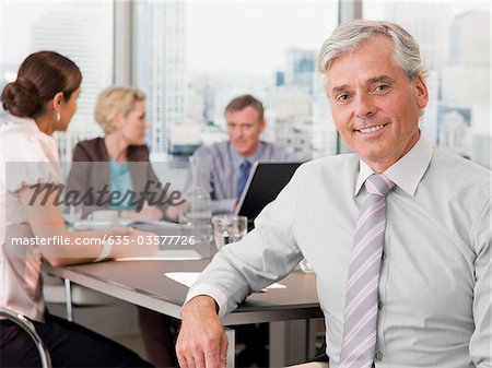 Smiling businessman in conference room Stock Photo - Premium Royalty-Free, Image code: 635-03577726
