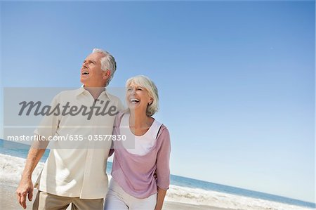 Laughing senior couple on beach Stock Photo - Premium Royalty-Free, Image code: 635-03577830