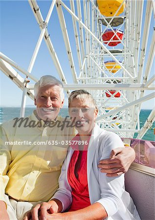Smiling senior couple on ferris wheel at amusement park Stock Photo - Premium Royalty-Free, Image code: 635-03577896