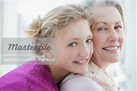 Smiling grandmother and granddaughter hugging Stock Photo - Premium Royalty-Free, Image code: 635-03578123
