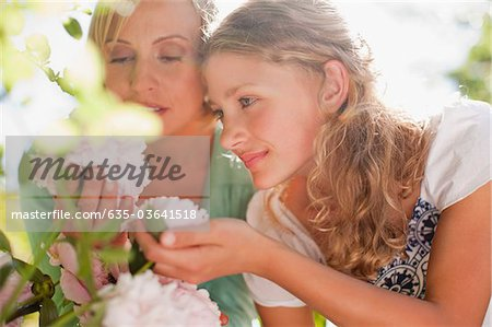 Mother and daughter smelling flowers Stock Photo - Premium Royalty-Free, Image code: 635-03641518