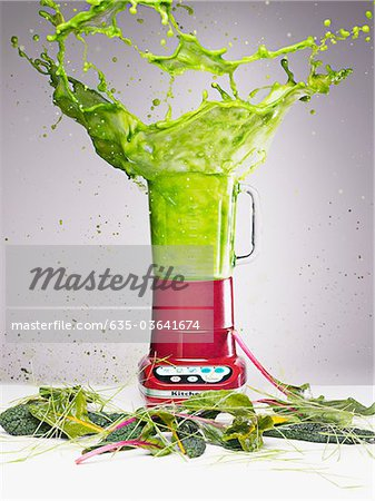 Vegetable juice splashing from blender Stock Photo - Premium Royalty-Free, Image code: 635-03641674