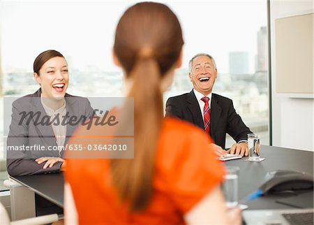 Business people laughing in conference room Stock Photo - Premium Royalty-Free, Image code: 635-03642010