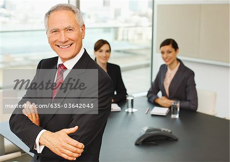 Smiling business people in conference room Stock Photo - Premium Royalty-Free, Image code: 635-03642043
