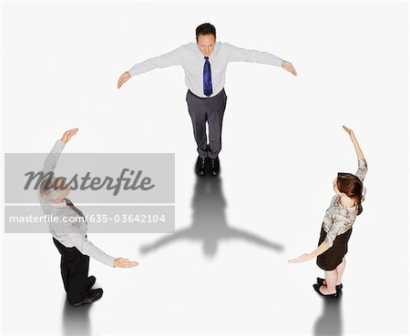 Business people forming circle with outstretched arms Stock Photo - Premium Royalty-Free, Image code: 635-03642104