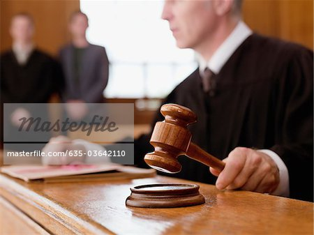 Judge holding gavel in courtroom Stock Photo - Premium Royalty-Free, Image code: 635-03642110