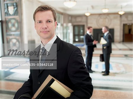 Smiling lawyer in lobby Stock Photo - Premium Royalty-Free, Image code: 635-03642118