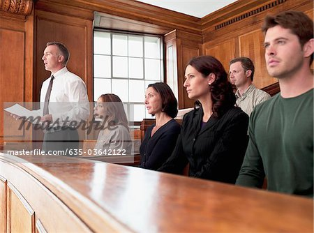 Jury sitting in courtroom Stock Photo - Premium Royalty-Free, Image code: 635-03642122