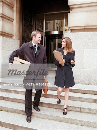 Lawyers leaving courthouse with files and box Stock Photo - Premium Royalty-Free, Image code: 635-03642131