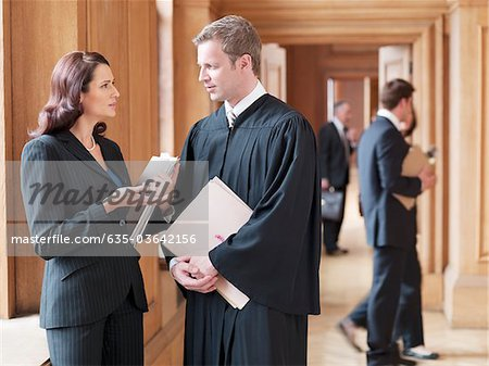 Judge and lawyer talking in corridor Stock Photo - Premium Royalty-Free, Image code: 635-03642156