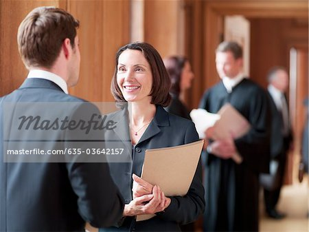 Lawyers talking in corridor Stock Photo - Premium Royalty-Free, Image code: 635-03642157