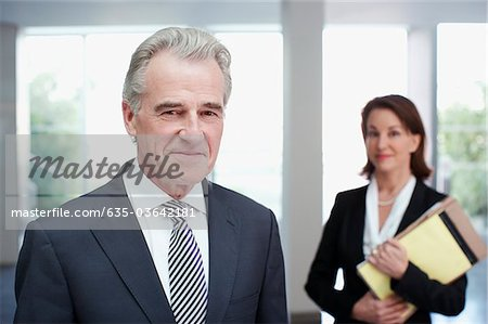Smiling business people in office Stock Photo - Premium Royalty-Free, Image code: 635-03642181