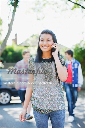 Teenage girl talking on cell phone Stock Photo - Premium Royalty-Free, Image code: 635-03684884
