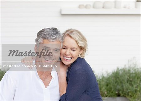 Smiling couple hugging outdoors Stock Photo - Premium Royalty-Free, Image code: 635-03685105