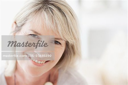 Close up of smiling woman Stock Photo - Premium Royalty-Free, Image code: 635-03685190