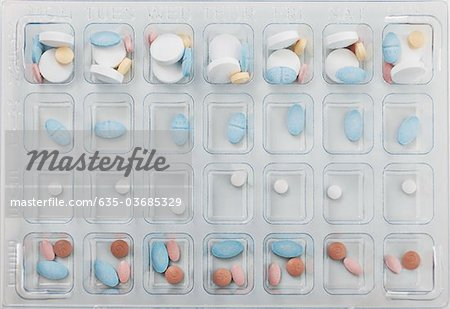 Close up of daily pill box Stock Photo - Premium Royalty-Free, Image code: 635-03685329