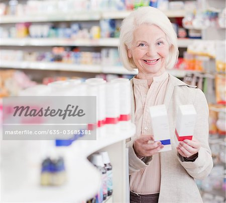 Senior woman comparing packages in drug store Stock Photo - Premium Royalty-Free, Image code: 635-03685381