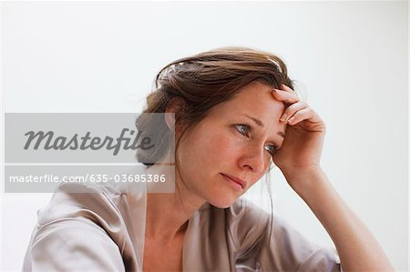 Depressed woman with head in hands Stock Photo - Premium Royalty-Free, Image code: 635-03685386