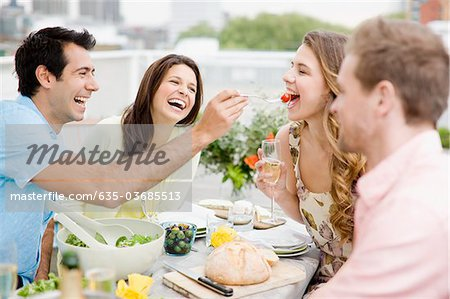 Couples enjoying party on balcony Stock Photo - Premium Royalty-Free, Image code: 635-03685513