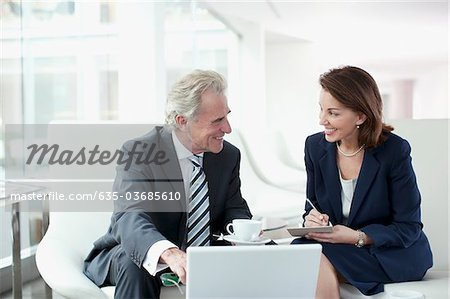 Business people working and drinking coffee Stock Photo - Premium Royalty-Free, Image code: 635-03685610