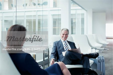 Business people waiting in airport Stock Photo - Premium Royalty-Free, Image code: 635-03685689