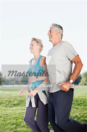 Couple jogging together outdoors Stock Photo - Premium Royalty-Free, Image code: 635-03716060
