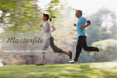 Couple running together Stock Photo - Premium Royalty-Free, Image code: 635-03716064