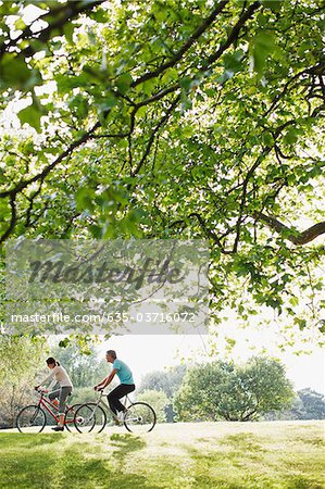 Couple riding bicycles together Stock Photo - Premium Royalty-Free, Image code: 635-03716072