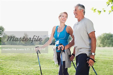 Smiling couple hiking together Stock Photo - Premium Royalty-Free, Image code: 635-03716092