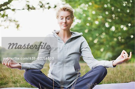 Tranquil woman practicing yoga Stock Photo - Premium Royalty-Free, Image code: 635-03716103