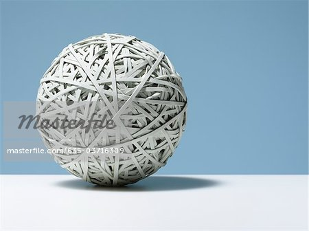 Close up of white rubber band ball Stock Photo - Premium Royalty-Free, Image code: 635-03716309