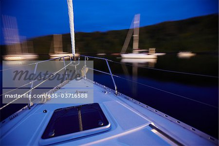 Bow of boat sailing on lake Stock Photo - Premium Royalty-Free, Image code: 635-03716588