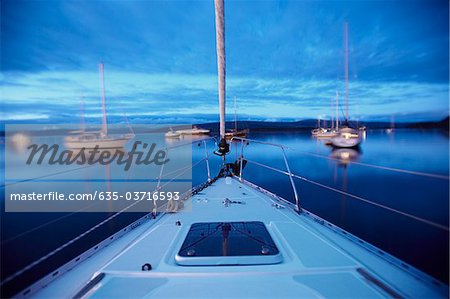 Bow of boat sailing on lake Stock Photo - Premium Royalty-Free, Image code: 635-03716593