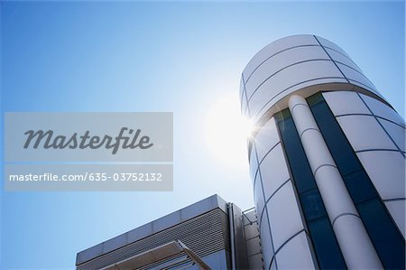 Sun shining over modern, circular office building Stock Photo - Premium Royalty-Free, Image code: 635-03752132
