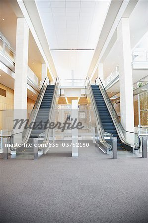 Escalators in modern office building Stock Photo - Premium Royalty-Free, Image code: 635-03752180
