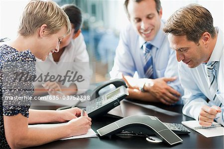 Business people in meeting on conference call Stock Photo - Premium Royalty-Free, Image code: 635-03752398